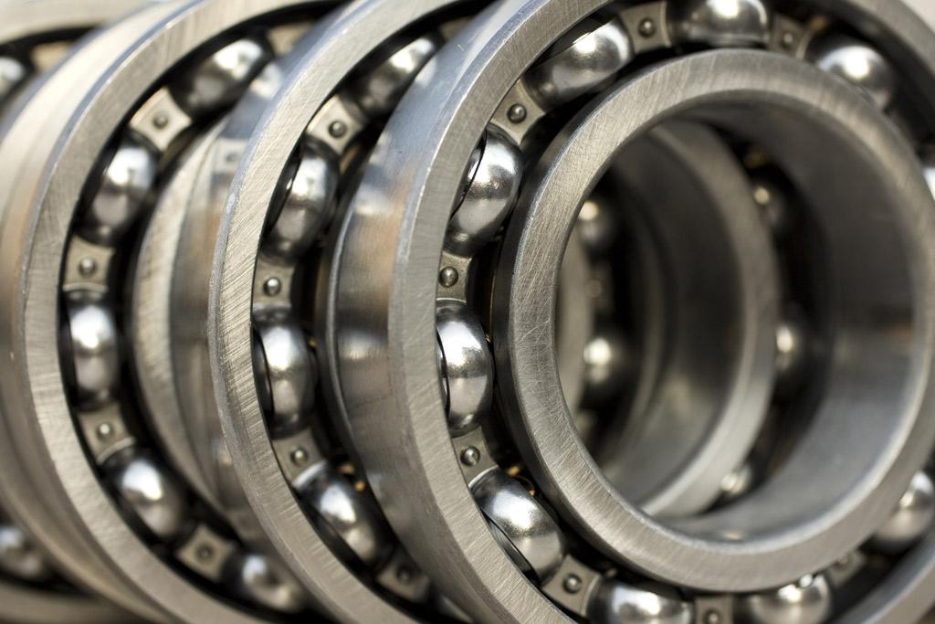 Stack of three ball bearing parts.