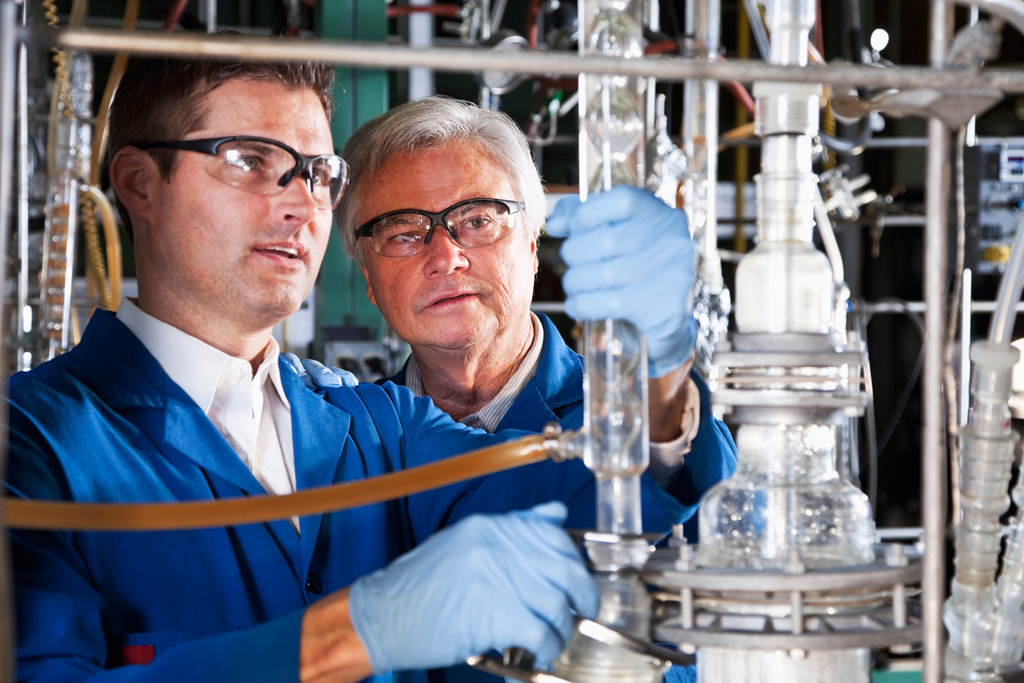 Two chemists reviewing equipment